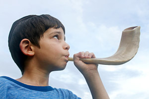 A child blowing a shofar: 9607433