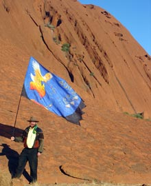 David at Ayers Rock with banner and pole